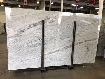Colonial white luxury granite and quartzsite stone slab for book-matched background